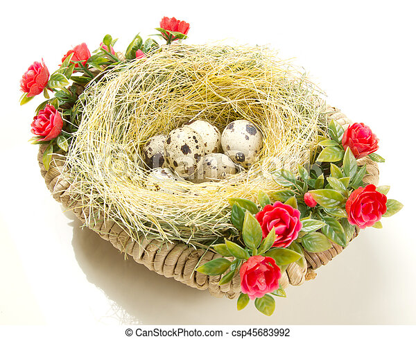 Easter quail eggs in the nest - csp45683992