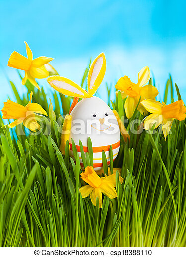 Easter rabbit on  green grass  - csp18388110