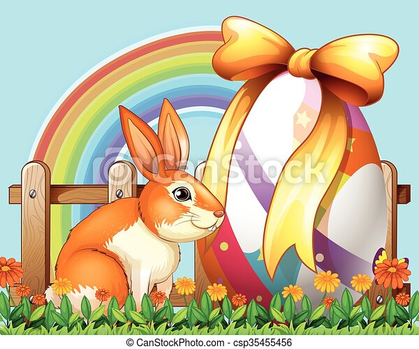 Easter rabbit with egg in the yard - csp35455456