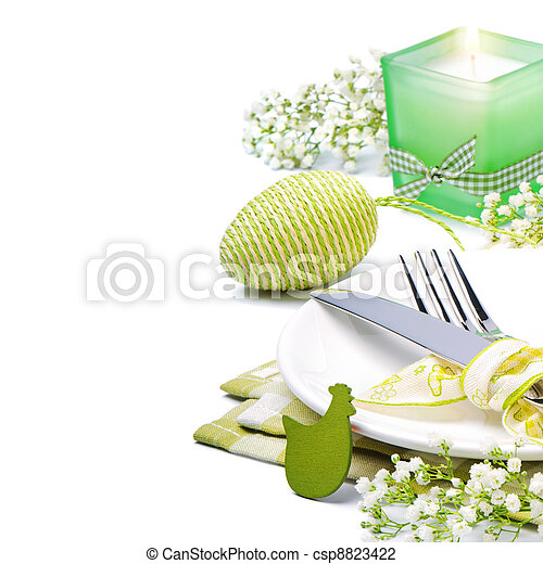 Easter table setting with candle and flowers - csp8823422