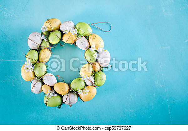 Easter Wreath On Heavenly Blue Background - csp53737627