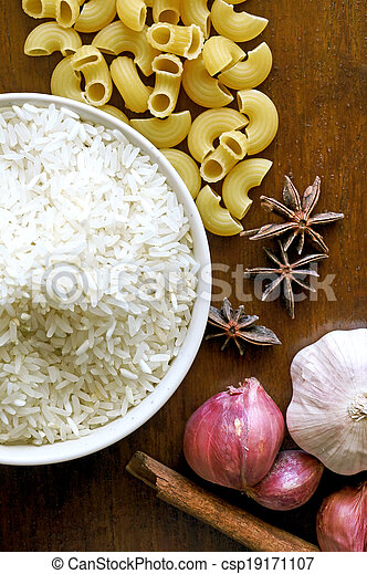 eastern food spice herb rice garlic  red onion on wood table background - csp19171107