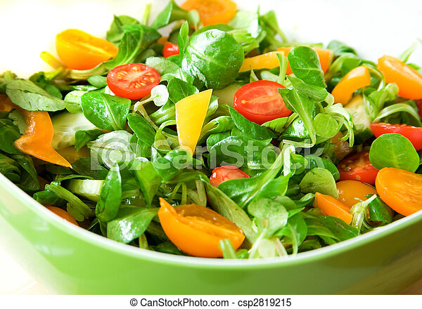 Eat healthy! Fresh vegetable salad served in a green salad bowl - csp2819215