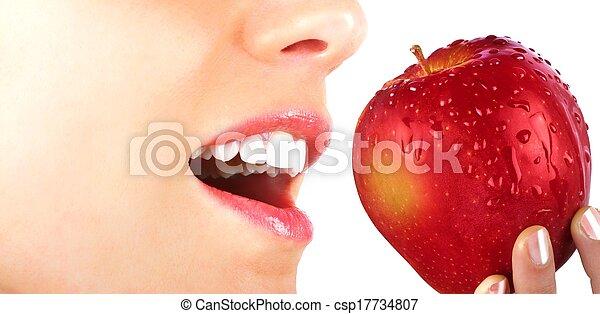 Eating an apple - csp17734807