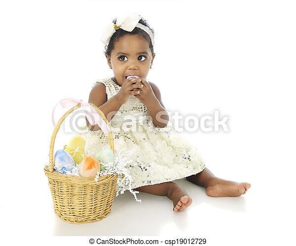 Eating Easter Eggs - csp19012729