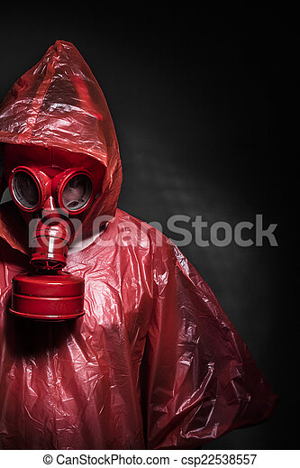 Ebola infection concept, man with red gas mask - csp22538557