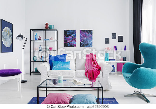 Marvelous Eclectic Living Room With Blue Egg Chair Metal Coffee Table And White Couch With Colorful Pillows Real Photo With Copy Space Download Free Architecture Designs Rallybritishbridgeorg