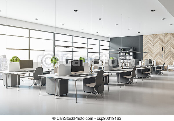 Eco style interior design in modern open space office with grey tables and chairs, wooden decor wall and concrete floor - csp90019163