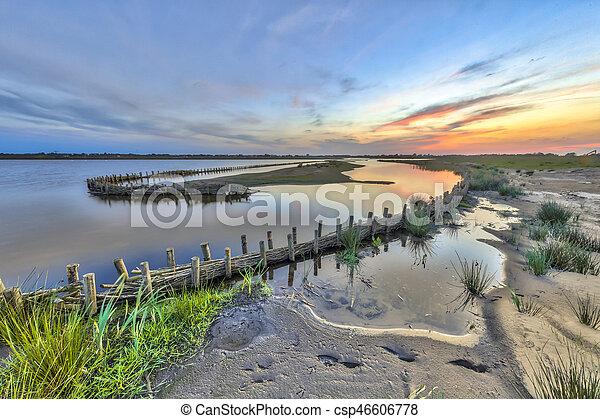 Ecological wet berm banks in development area - csp46606778