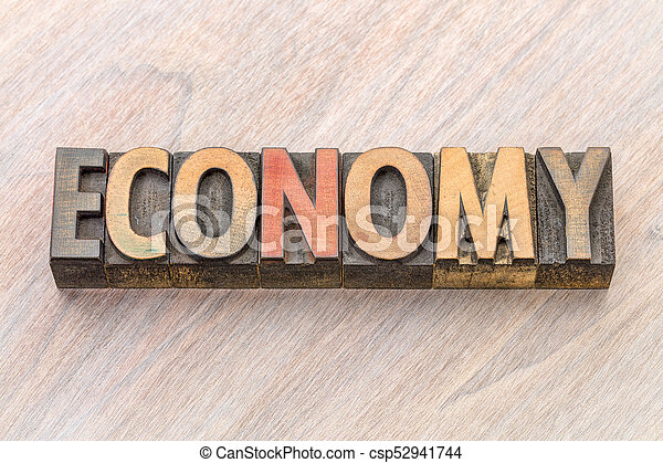 economy word abstract in wood type - csp52941744