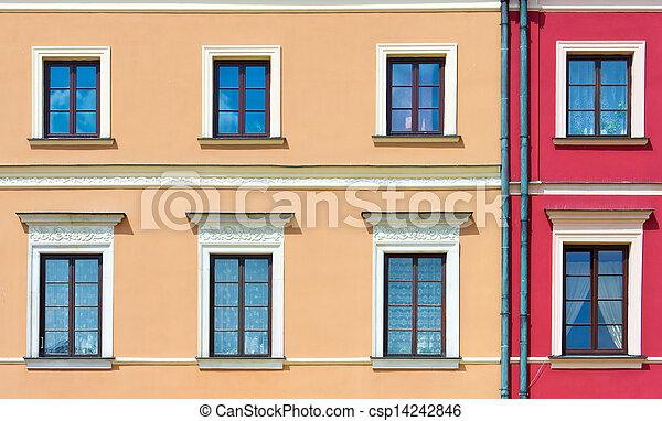La fachada de un edificio con ventanas - csp14242846