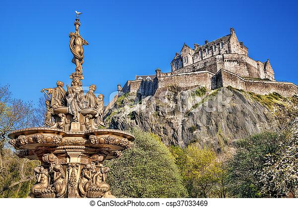 Edinburgh castle with fountain in Scotland - csp37033469