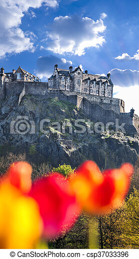 Edinburgh Castle with spring tulips in Scotland - csp37033396