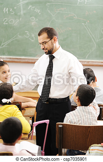 Education activities in classroom at school, happy children learning - csp7035901