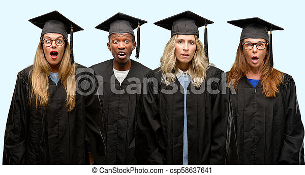 Education concept, university graduate woman and man group scared in shock, expressing panic and fear - csp58637641