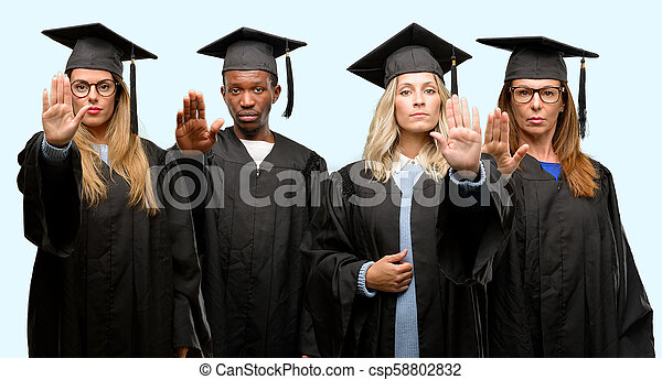 Education concept, university graduate woman and man group annoyed with bad attitude making stop sign with hand, saying no, expressing security, defense or restriction, maybe pushing - csp58802832