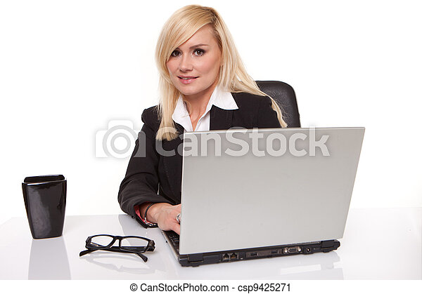 Efficient businesswoman working on her laptop - csp9425271