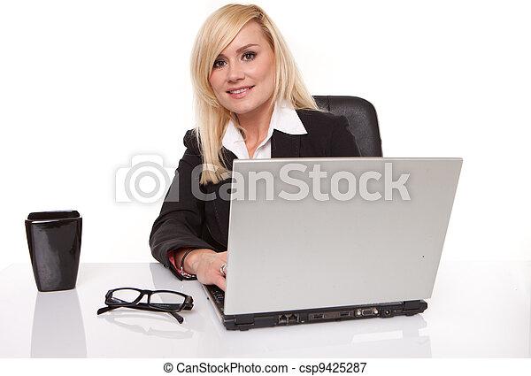 Efficient businesswoman working on her laptop - csp9425287