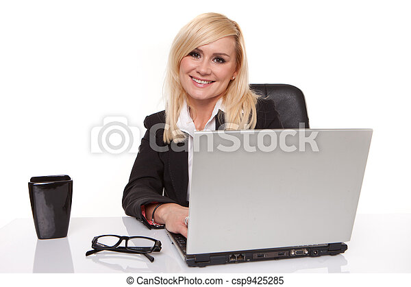 Efficient businesswoman working on her laptop - csp9425285