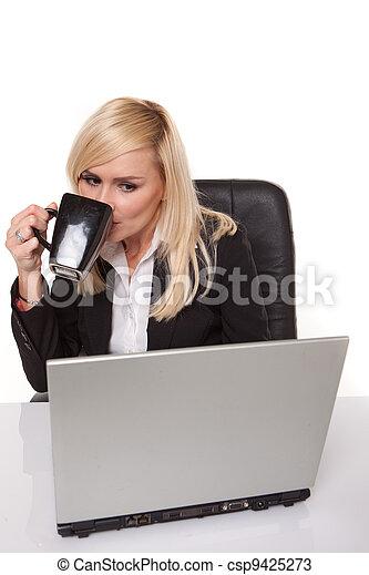 Efficient businesswoman working on her laptop - csp9425273