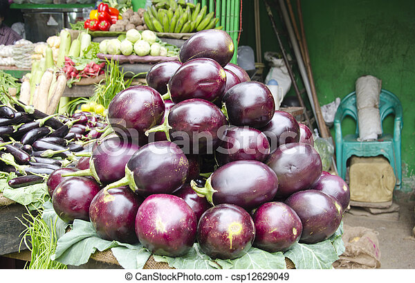 eggplants and other vegetables in asia market - csp12629049