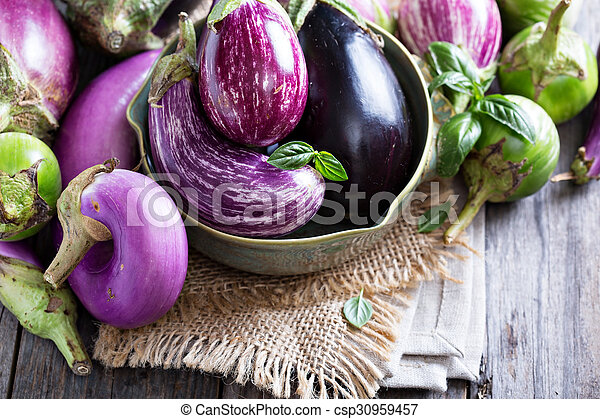 Eggplants of different variety on the table - csp30959457