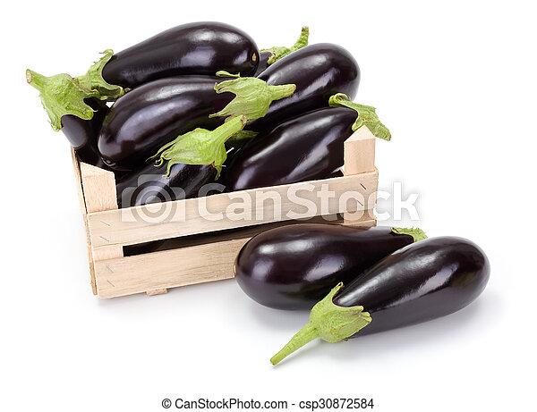 Eggplants (Solanum melongena) in wooden crate - csp30872584