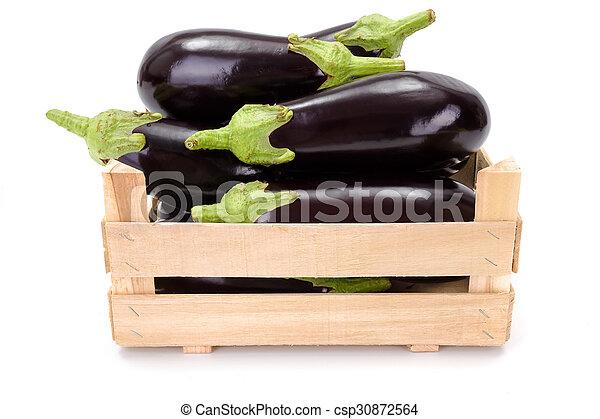 Eggplants (Solanum melongena) in wooden crate - csp30872564