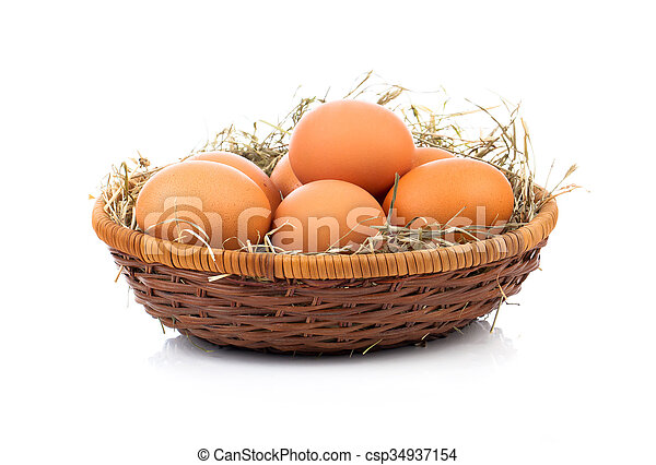 Eggs in basket isolated on white background - csp34937154
