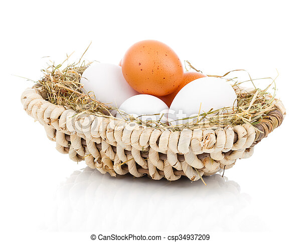 Eggs in basket isolated on white background - csp34937209