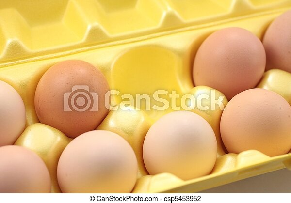 Eggs in yellow packing box. - csp5453952