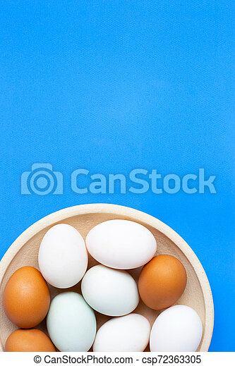 Eggs on blue background. Top view - csp72363305