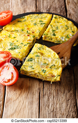 Egyptian food: omelet Igga with greens and onions close-up  vertical