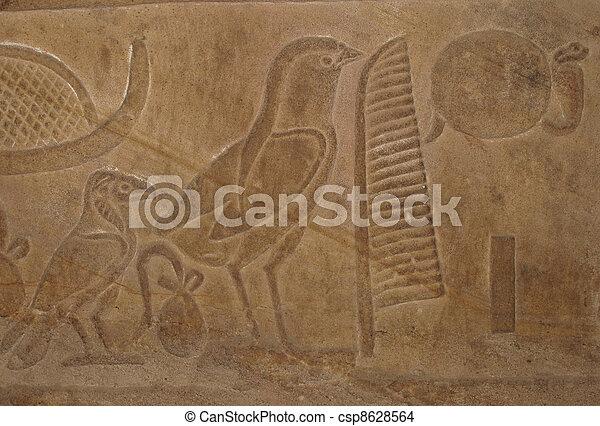 Egyptian Hieroglyphic Writing With Bird Symbols On An Stock Photo