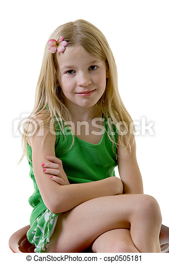 Cute little eight year old girl with flower in her hair ...