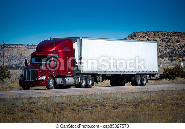 Eighteen wheel big rig tractor with trailer on highway. Trucking industry - csp85027570