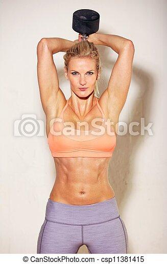 Sudoroso atleta haciendo ejercicio - csp11381415