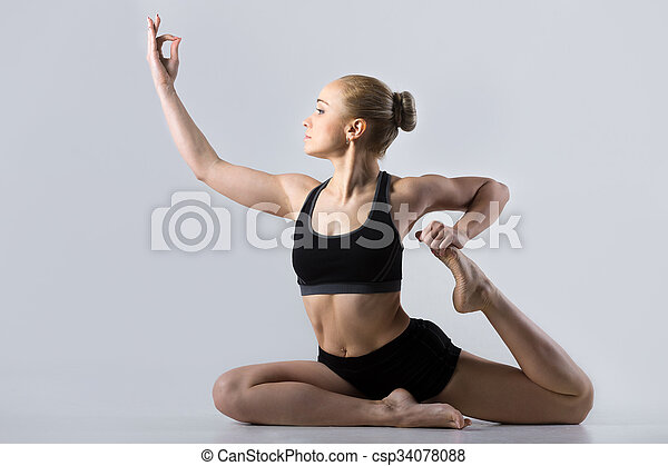 sporty beautiful young woman practicing yoga doing one