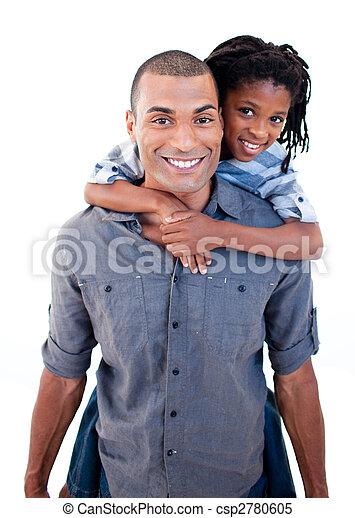 Padre étnico dando a su hijo un paseo por cerdo - csp2780605