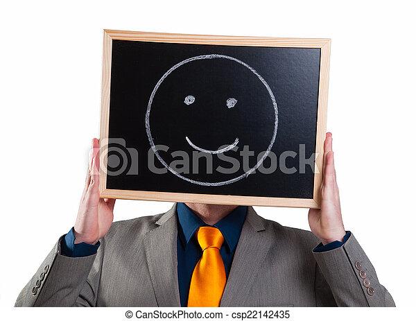Hombre de negocios escondiendo su cara con un cartel blanco con una sonrisa - csp22142435