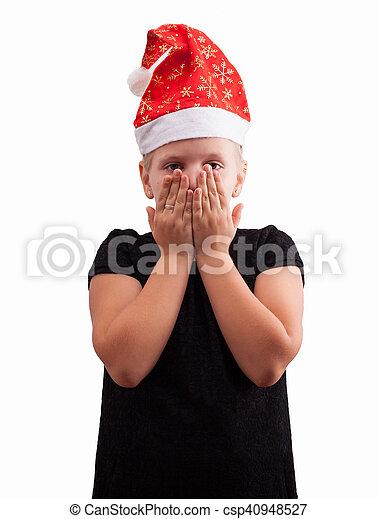 La chica con un sombrero de Navidad rojo cubre su cara - csp40948527