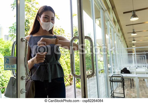Elbow to opening door. New normal lifestyle. - csp82264084