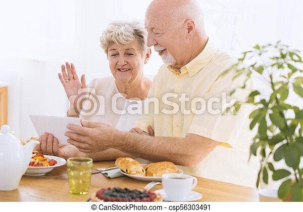 Elder couple watching photos - csp56303491