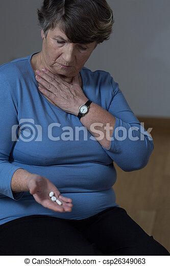 Elder woman taking medicine - csp26349063