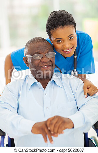 elderly african american man and caring young caregiver - csp15622087