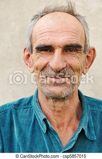 Elderly bald man, natural smile and positive grimace - csp5857015