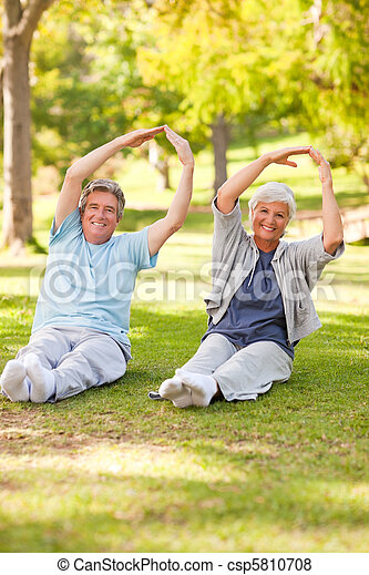 Elderly couple doing their stretches in the park - csp5810708