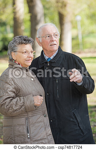 Elderly couple in the woods - csp74817724