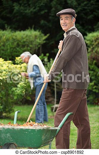 Elderly couple in their garden - csp8901892