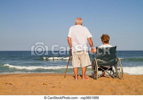 elderly couple on beach - csp3601689